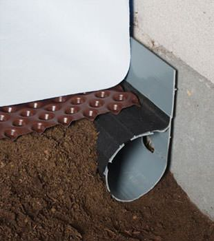 Closeup of a crawl space drainage system installed in Timmonsville