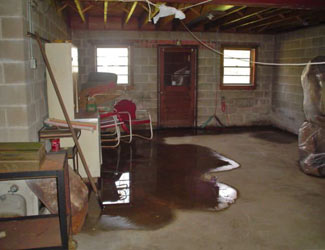 a flooded basement floor in a Little River home