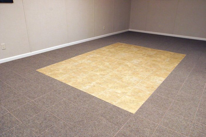 tiled and carpeted basement flooring installed in a North Myrtle Beach home